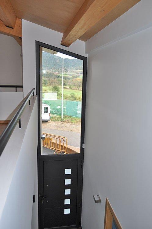Porta i tancaments d'alumini